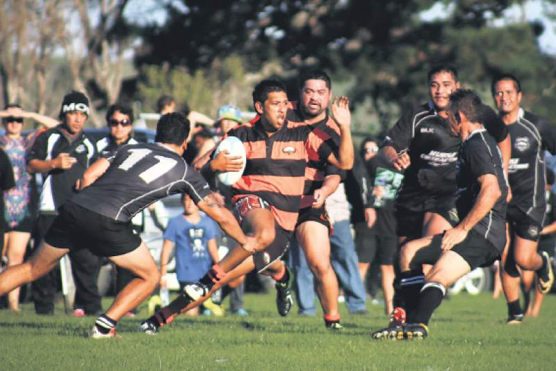 Hikurangi second five Caleb Lewis tries to stop Waiapu's Nathan Huriwai, who has Tripoli Poi in support Hiku fullback Kris Palmer is at right. Picture by Paul Rickard